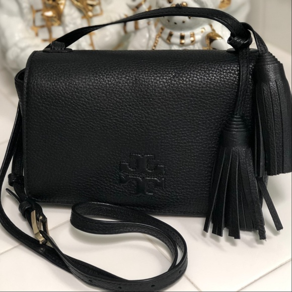 fbb29d0b31155 Tory Burch Thea Mini Leather Crossbody Bag. M 5bfdbdd4c617778bbf49926c